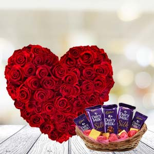 Heart Shaped Roses With Chocolates: Anniversary flowers & chocolates Warangal,  India