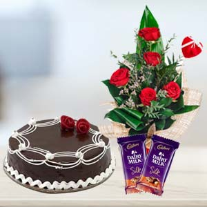 Cadbury Temptations Combo With Flowers: Anniversary flowers & cake Delhi,  India