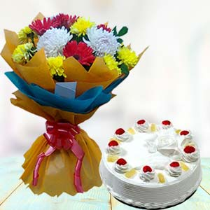 Fresh Mix Flowers With Pineapple Cake: Birthday Jharsuguda,  India