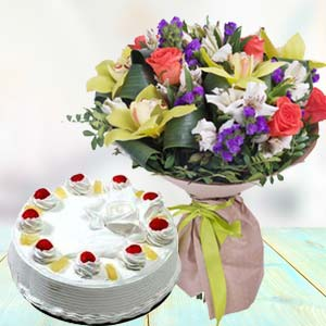 Mix Fresh Flowers With Pineapple Cake: Unique birthday gifts Trivandrum,  India