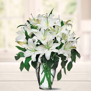 White Lillies In A Vase: Anniversary flowers Baroda,  India