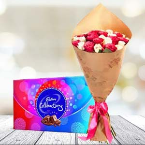 Mix Roses And Chocolates: 1st birthday gifts Panchkula,  India