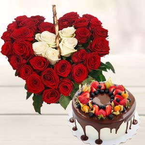 Heart Shape Arrangement With Cake: Birthday flowers & cake Junagadh,  India