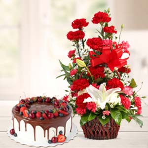 Carnations With Chocolate Cake: 1st birthday gifts Calcutta,  India